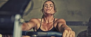 female athlete on the rowing machine